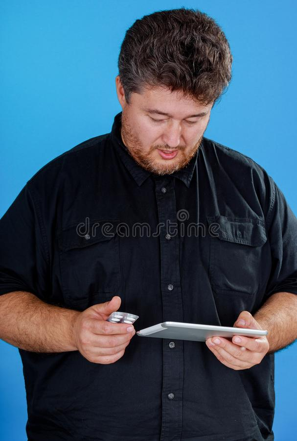 Man using tablet pc on pills and vitamin with online using tablet, prescribing treatment modern technologies royalty free stock images