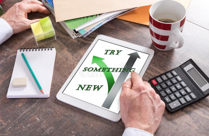 Try something new concept on a tablet. Man using a tablet showing a try something new concept royalty free stock photos