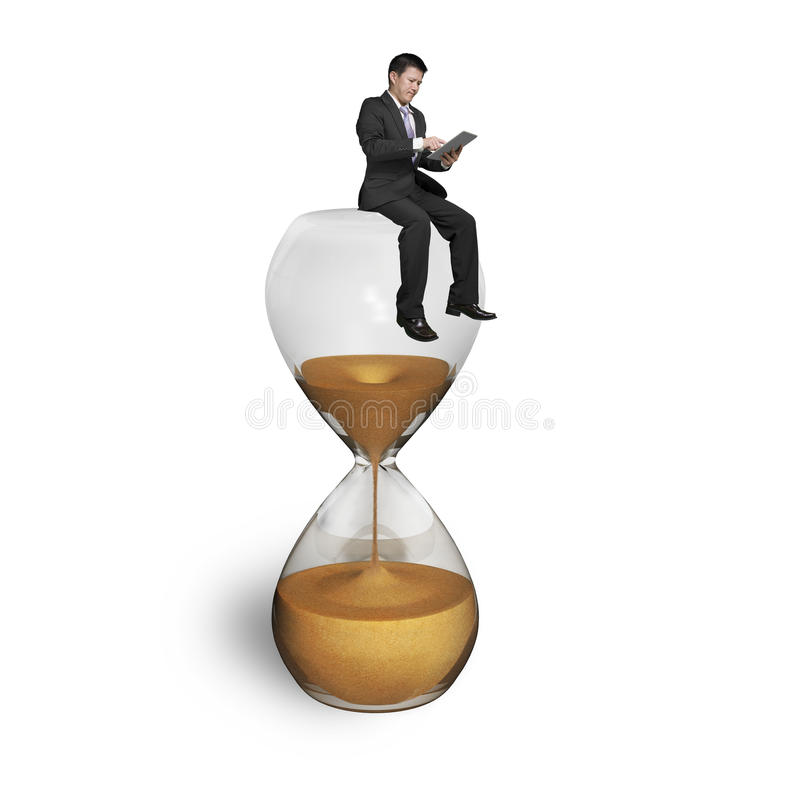 Man using tablet and sitting on hourglass. With white background stock images