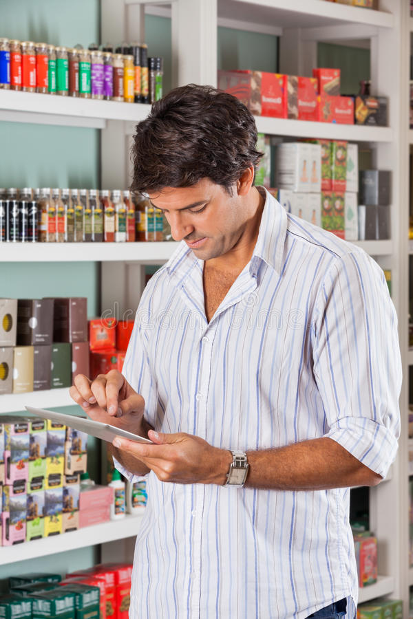 Download Man Using Tablet In Store stock image. Image of market - 37112071