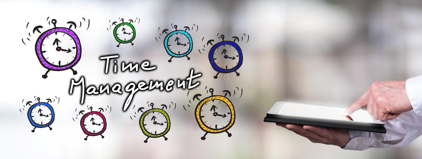 Time management concept with man using a tablet. Man using a tablet with time management concept royalty free stock image
