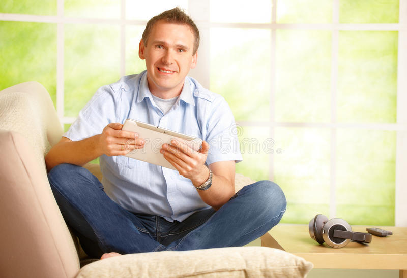 Download Man using white tablet stock image. Image of happy, computer - 24317969