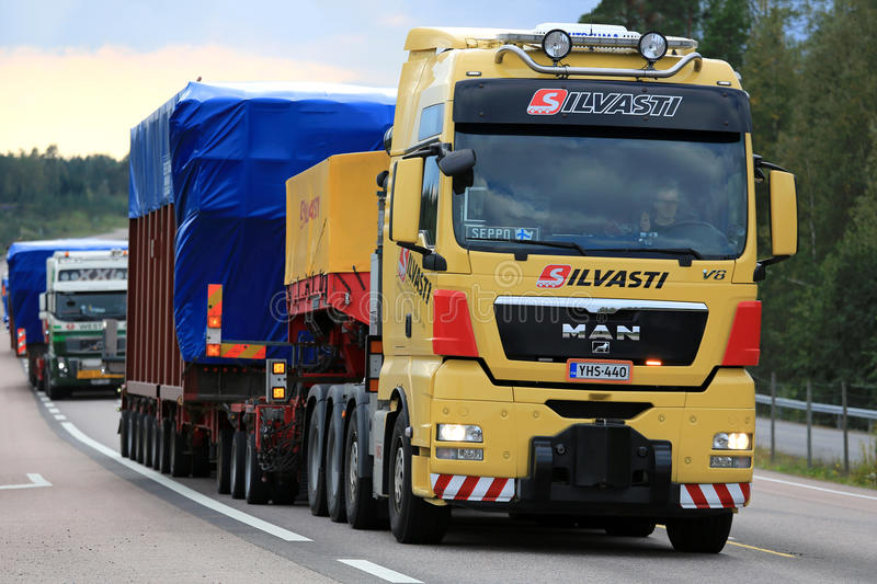 MAN V8 Semi Hauls Wide Load on the Road royalty free stock images