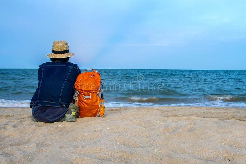 Man vacation with sunset over the tropical beach and sea a beaut. Iful in thailand stock image