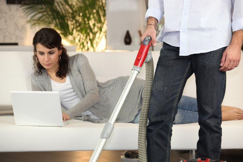 Man vacuuming royalty free stock photo