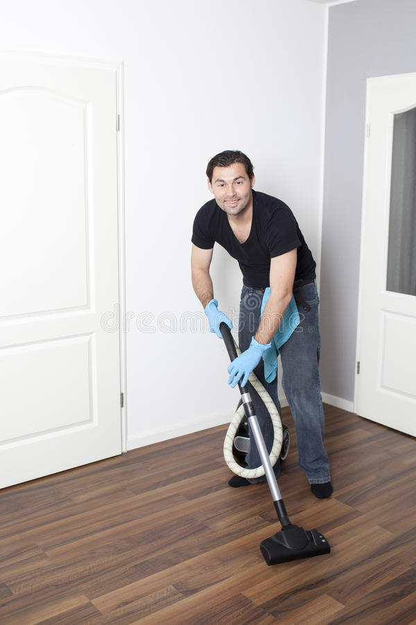 Download Man vacuums flat stock image. Image of dust, cheerful - 24686741