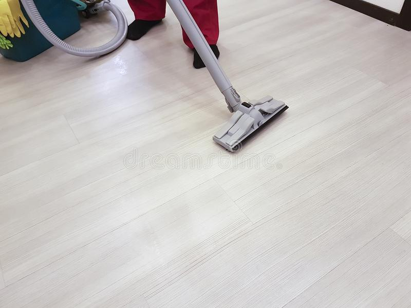 The man vacuums the floor cleaning equipment scene stock photos