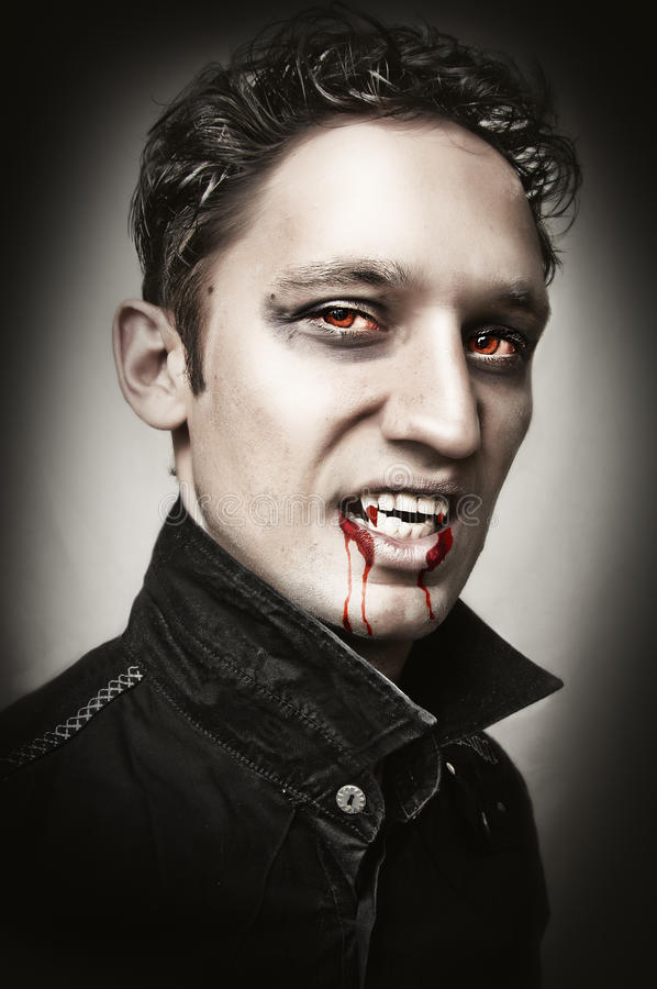 Man with vampire style bangs, blood royalty free stock images