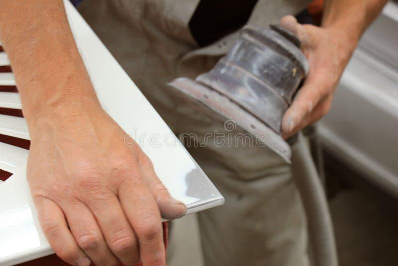 Man in vehicle repair shop stock photo