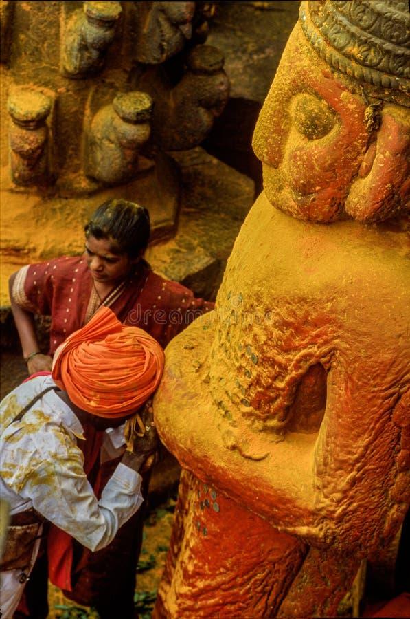 Man verdhiping at stone statyu at khandoba temple, jejuri, pune, Maharashtra, India royalty free stock photo