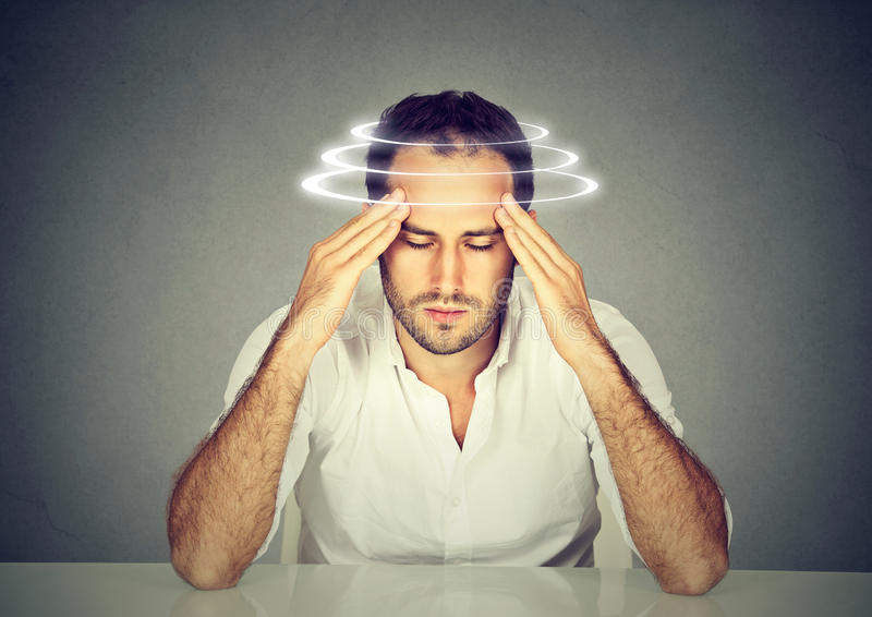 Man with vertigo. Young patient suffering from dizziness. royalty free stock photo