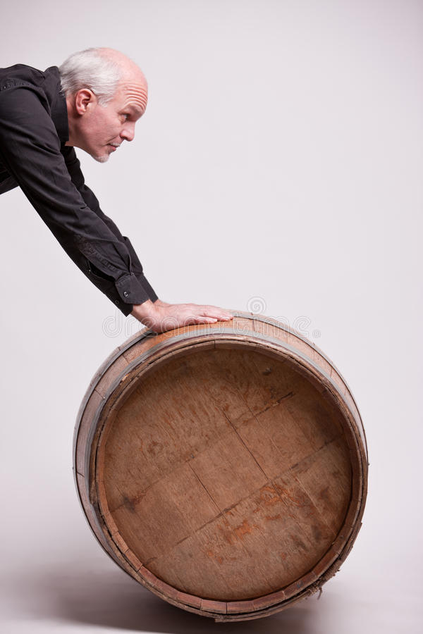 Man with a very big barrel. Perhaps of a genuine wine royalty free stock photo
