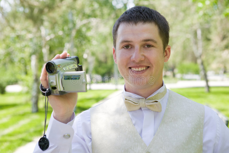 Download Man with videocamera stock image. Image of objective, happy - 6856825