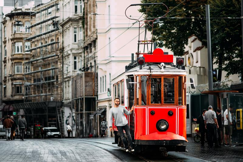 Man in a vintage tram on the Taksim Istiklal street in Istanbul. Man on public transport. Old Turkish tram on Istiklal street, royalty free stock images