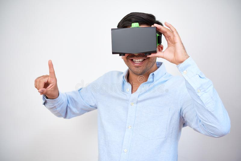Man in virtual reality glasses stock image