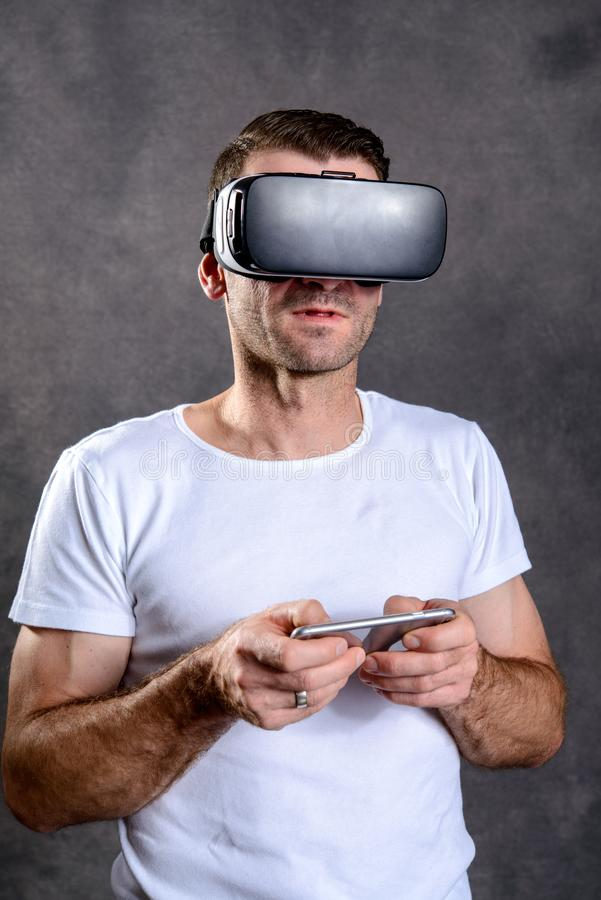 Man with virtual reality glasses pointing upward royalty free stock images