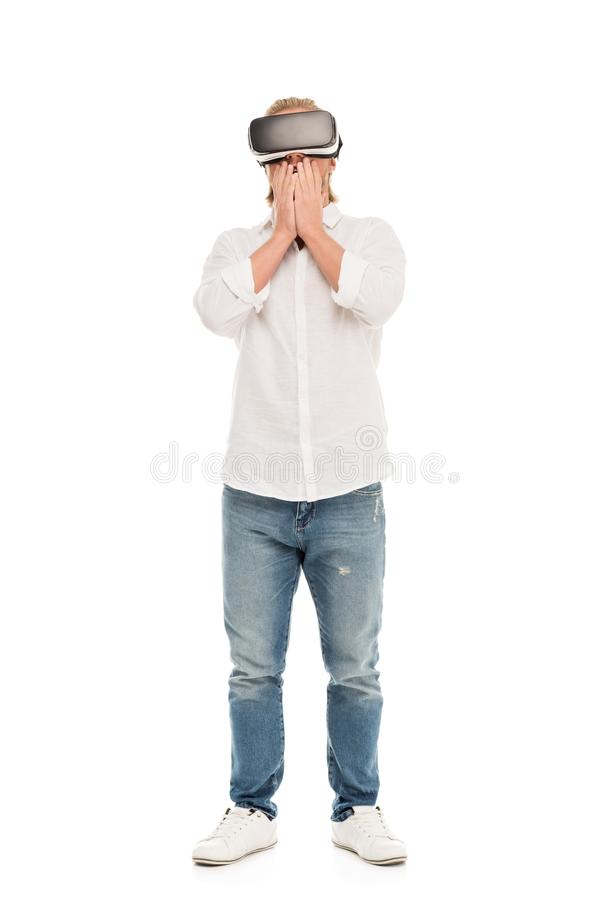 young man in virtual reality headset covering mouth with hands royalty free stock image