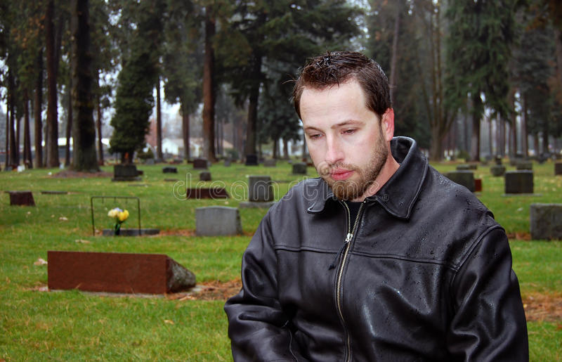 Man visiting cemetery royalty free stock photo