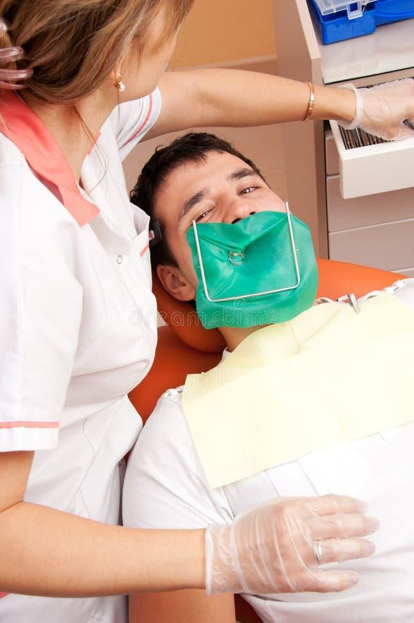 Man visiting dentist. Man at the dentist's surgery royalty free stock images