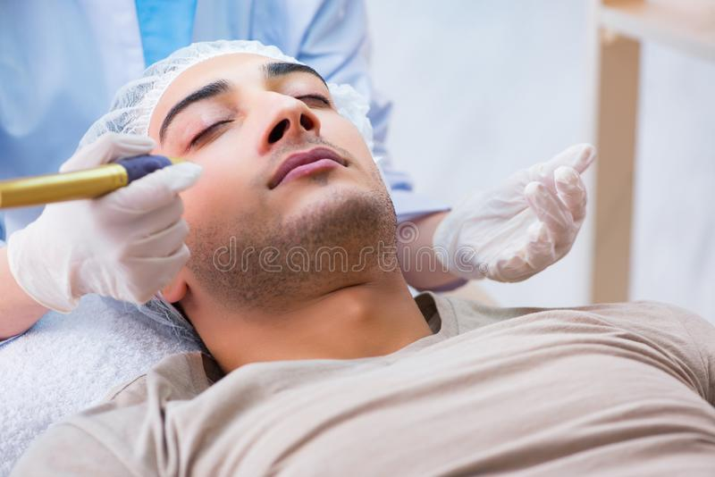 The man visiting dermatologyst for laser scar removal. Man visiting dermatologyst for laser scar removal royalty free stock photography
