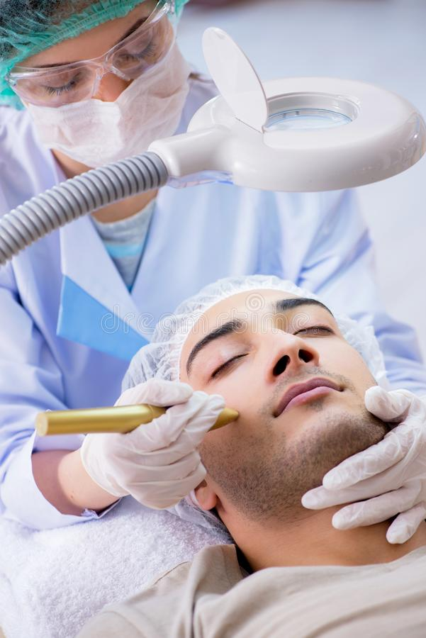 The man visiting dermatologyst for laser scar removal. Man visiting dermatologyst for laser scar removal stock photography