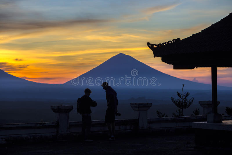 Man with and Volcano Agung as Background. stock photography