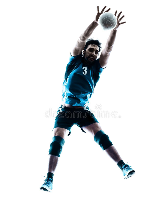 Man volleyball jumping silhouette. One caucasian man volleyball jumping in studio silhouette isolated on white background in studio silhouette isolated on white royalty free stock photos