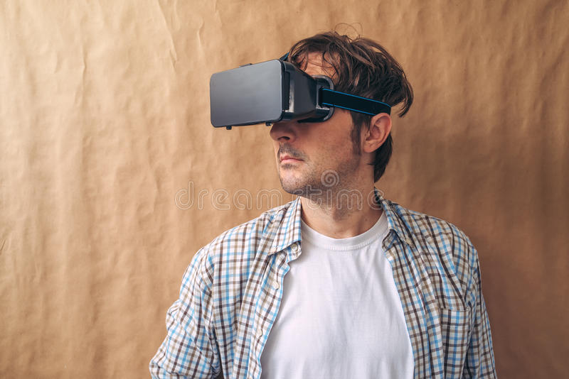 Man with VR goggles exploring virtual reality content. And enjoying in cyberspace environment royalty free stock photo