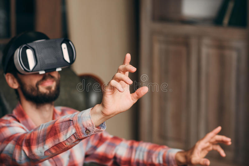 Man in vr goggles touching something, void royalty free stock images