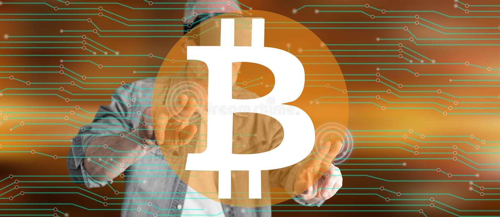 Man with VR headset touching a bitcoin concept on a touch screen. Man wearing a reality virtual headset touching a bitcoin concept on a touch screen with his royalty free stock image