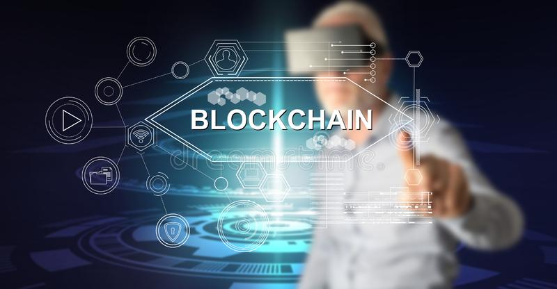 Man touching a blockchain concept royalty free stock photo