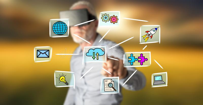 Man with VR headset touching a cloud computing concept on a touch screen. Man wearing a reality virtual headset touching a cloud computing concept on a touch stock photos