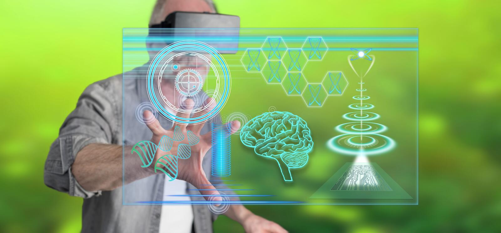 Man with VR headset touching a futuristic technologies concept on a touch screen. Man wearing a reality virtual headset touching a futuristic technologies royalty free stock images
