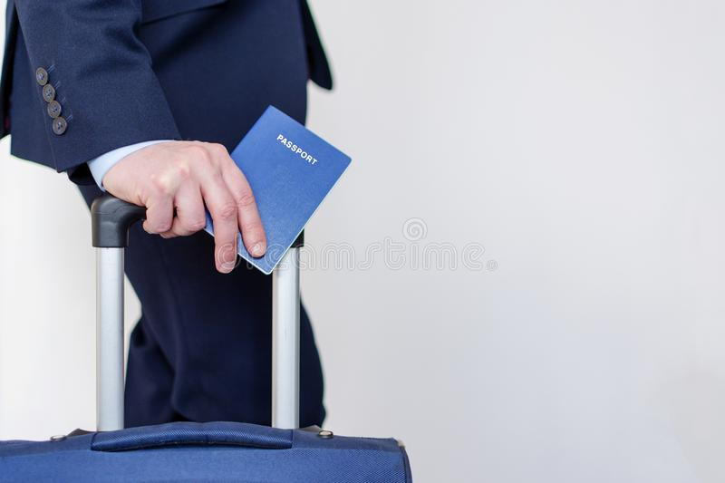 Man with passport and suitcase in his hands. stock photography