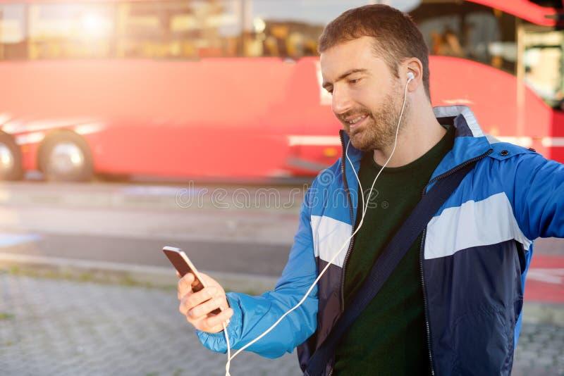 Man waiting at the bus station royalty free stock photo