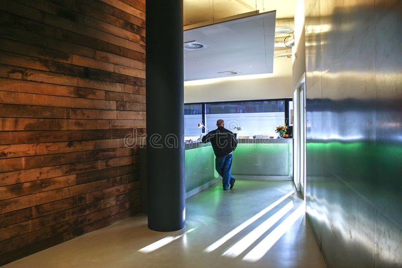 Man waiting at design reception royalty free stock image