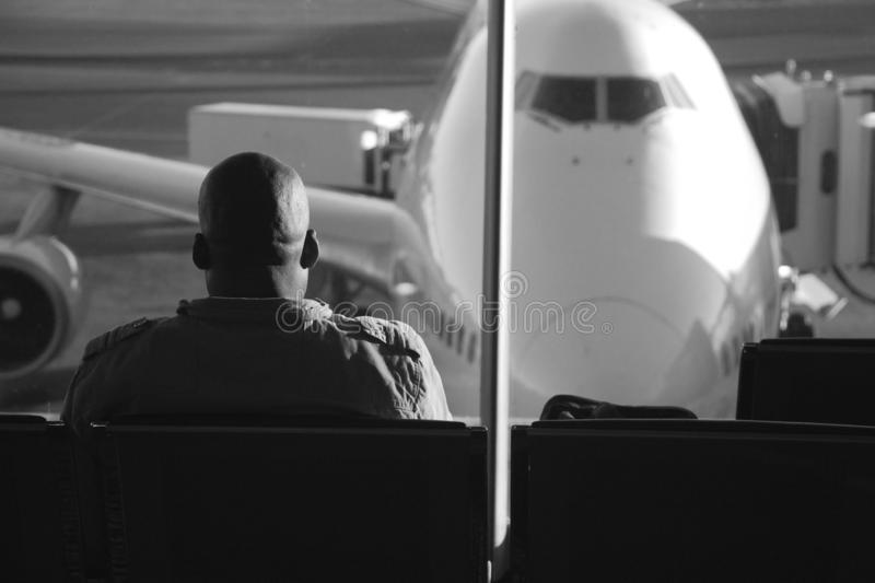 Johannesburg, Gauteng, South Africa - July 16, 2009: African passenger seated on airport lounge stock photography