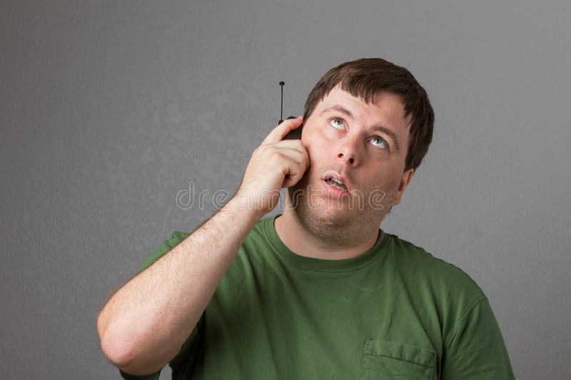 Man waiting on the phone. Could be a telemarketer on the line or he is waiting for customer service royalty free stock photography