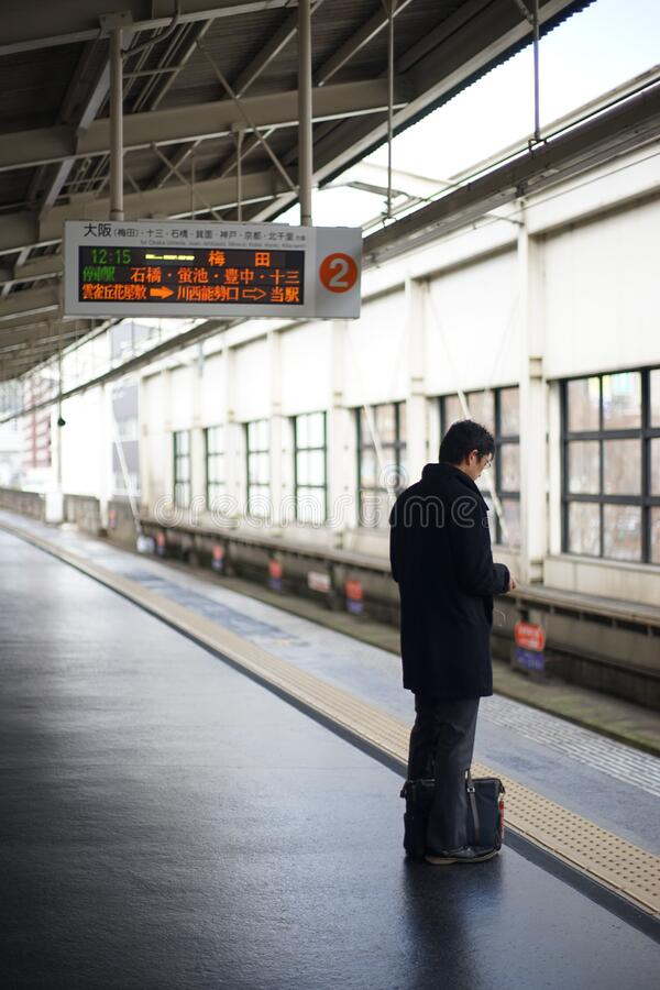 Man waiting for subway train in Japan royalty free stock images