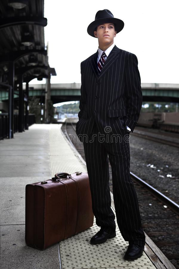 Man waiting for a train in 1940s attire stock photo