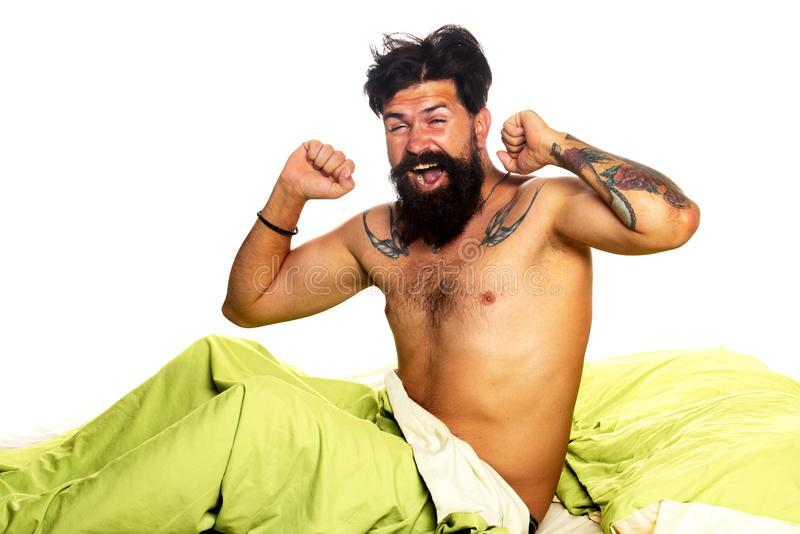 Man wake up in bed alone. Wake-up disorders concept. Violations of sleep and wakefulness. Bearded man sleeping on bed in. Man sleep in bed alone. Sleep disorders stock photos
