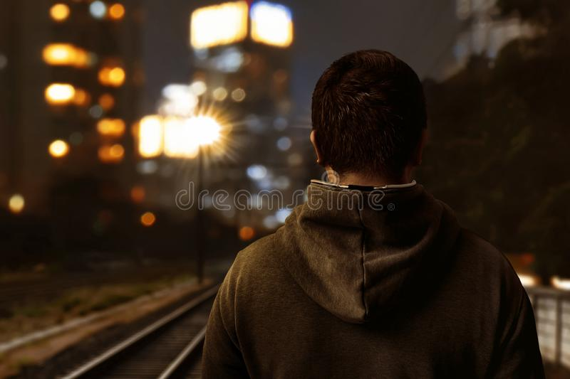 Man walking alone on railroad royalty free stock images