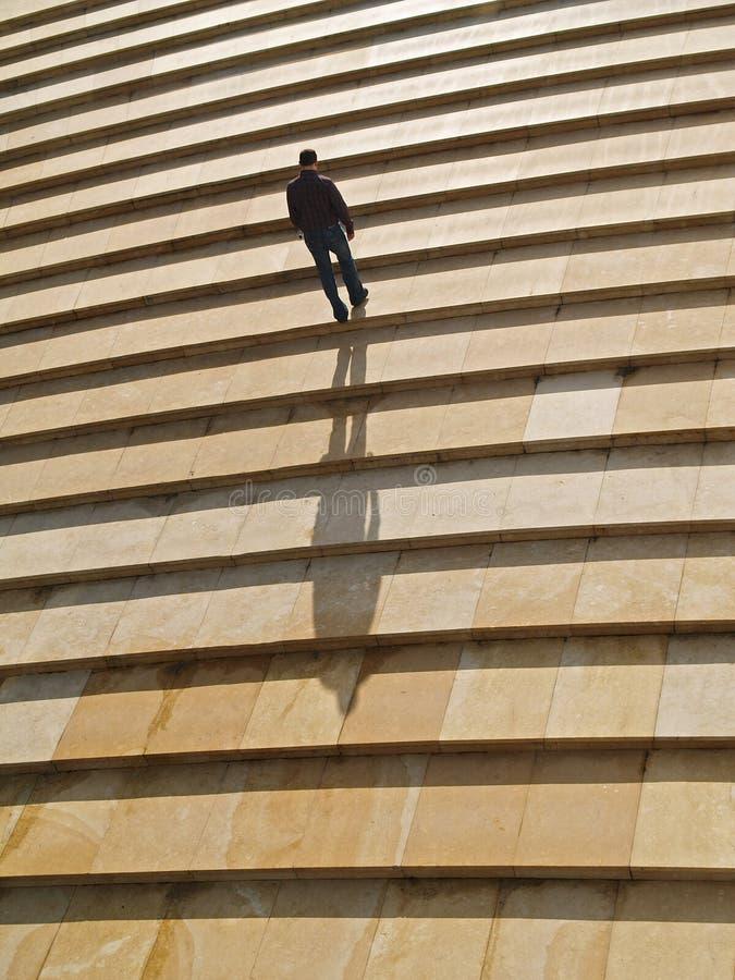 Man walking alone upstairs royalty free stock photos