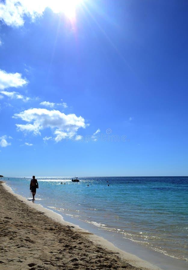 Man walking along the coast of the Caribbean sea. Cuba royalty free stock image