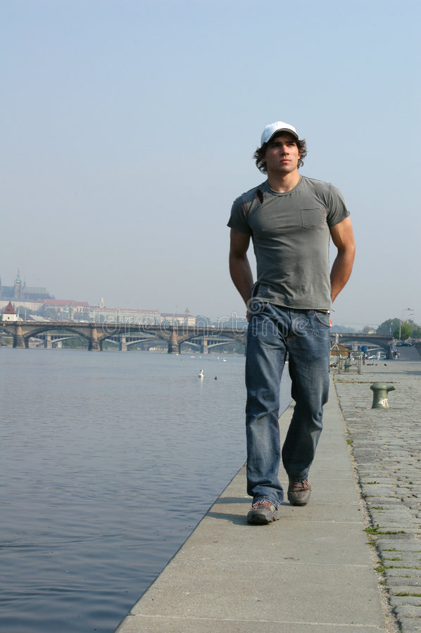 Man Walking Along the Embankment royalty free stock photo