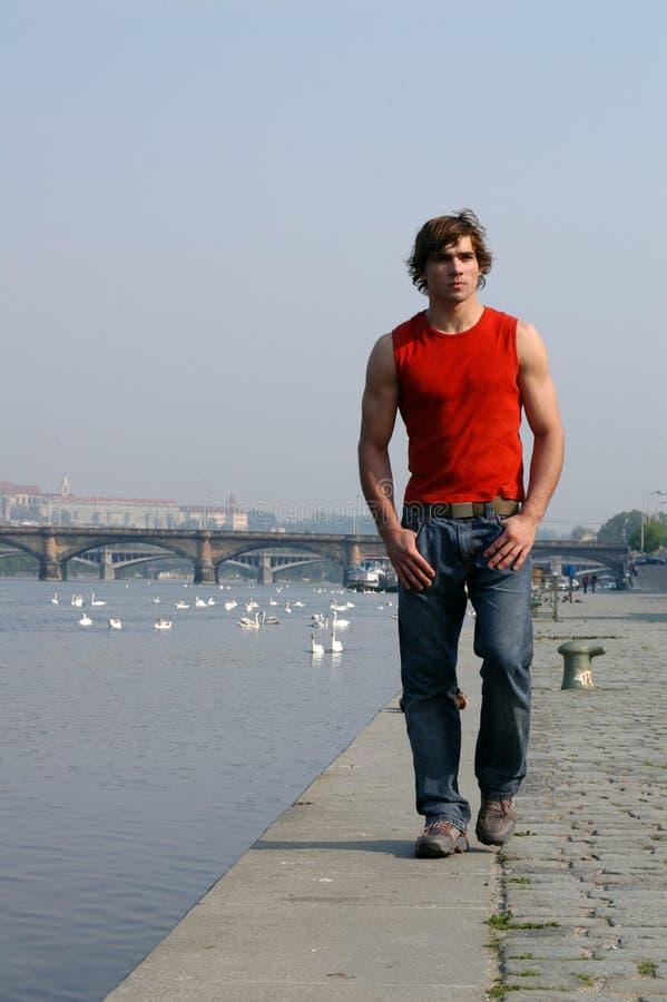 Man Walking Along the Embankment stock photography