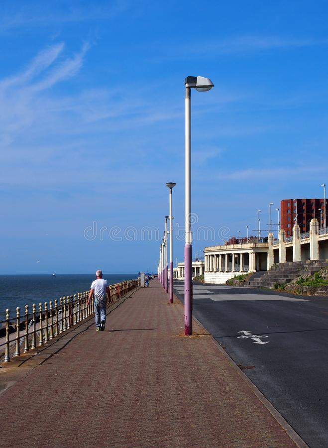 The long pedestrian walkway at the top of the north promenade in blackpool showing the seating and shelters along the coastline ir royalty free stock photos