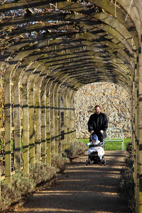 Free Man Walking Baby. Royalty Free Stock Photos - 17026258