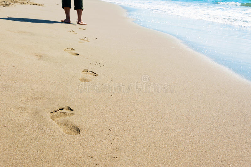 Man walking on the beach royalty free stock photography
