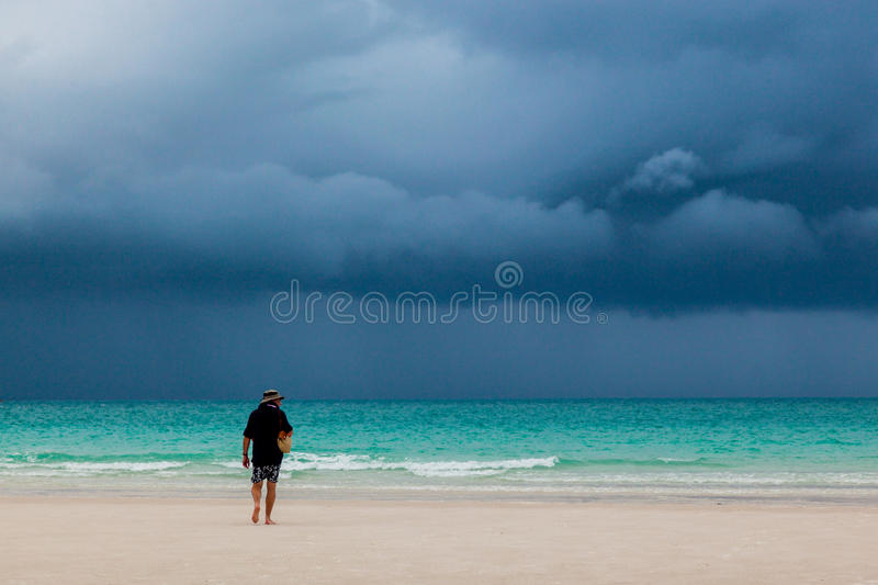 Man walking on beach royalty free stock image
